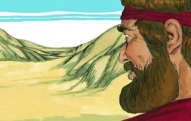 Un hombre va caminando por el desierto. Su atavío es muy sencillo.,