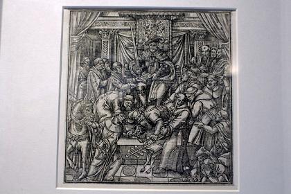 Grabado en que se representa a Enrique VIII pisando al papa Clemente VII ante la mofa de su corte. Foto: Diana Rodríguez