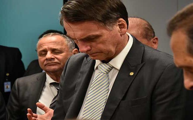 Bolsonaro junto a líderes evangélicos. / ED,
